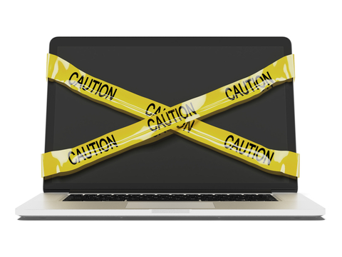 Caution signs on laptop