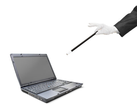 Magic wand and laptop