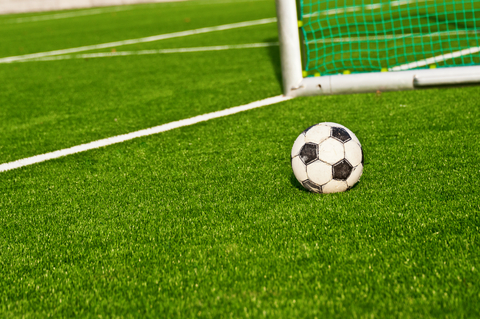 soccer ball with goal posts - focus on your goals